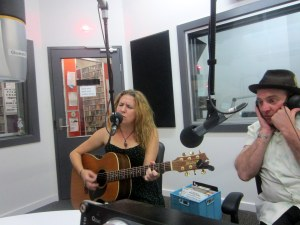 Courtney Robb sings while guest Snooks LaVie listens.